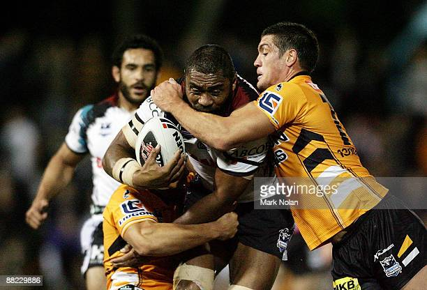 Petero Civoniceva of the Panthers is tackled during the round 13 NRL match between the Wests Tigers and the Penrith Panthers at Leichhardt Oval on...