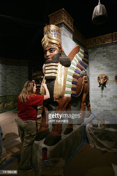 TO GO WITH AFP STORY BY MIRA OBERMAN USPOLITICSRELIGIONMUSEUMCREATIONISM Donna Barker and Stephanie Hola put the finishing touches on the Winged Bull...