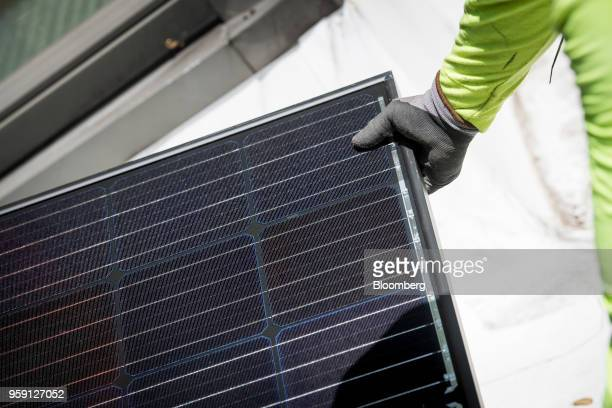 A PetersenDean Inc employee installs a solar panel on a home in Lafayette California US on Tuesday May 15 2018 California became the first state in...