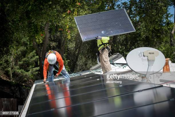 PetersenDean Inc employees install solar panels on the roof of a home in Lafayette California US on Tuesday May 15 2018 California became the first...