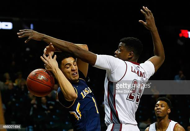 Peterson of the La Salle Explorers and Cady Lalanne of Massachusetts Minutemen battle for the ball during the Second Round of the Atlantic 10...