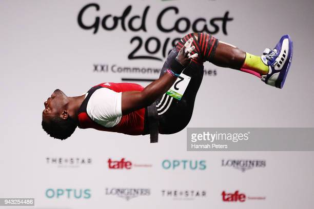 Petit David Minkoumba of Cameroon celebrates after making a lift in the Men's 94kg weightlifting final on day four of the Gold Coast 2018...