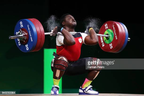Petit David Minkoumba of Cameroon competes in the Men's 94kg final during Weightlifting on day four of the Gold Coast 2018 Commonwealth Games at...