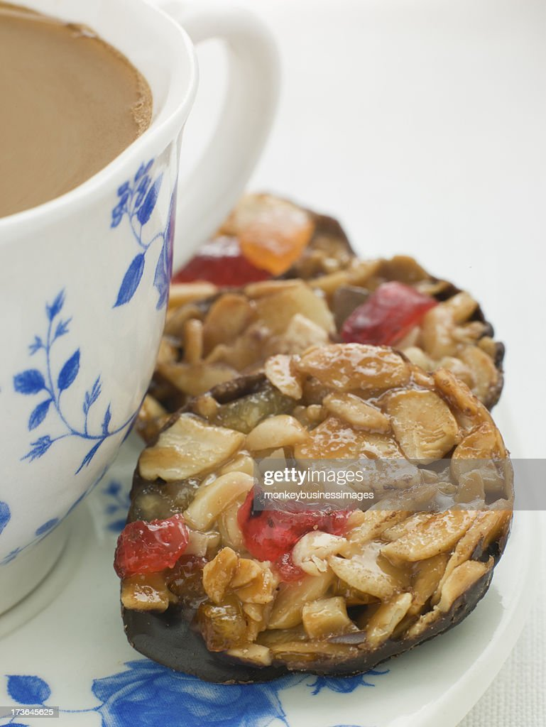 Petit Florentines with a Cup of Tea : Stock Photo