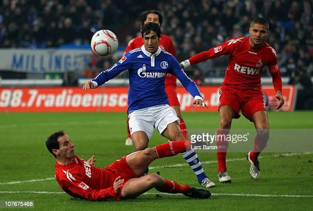 Petit of Koeln challenges Raul Gonzalez of Schalke during the Bundesliga match between FC Schalke 04 and 1 FC Koeln at Veltins Arena on December 18...