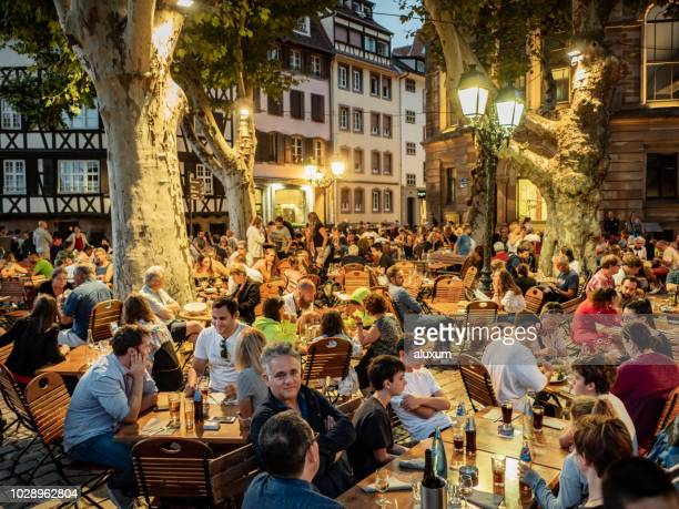 petite france strasbourg france - french cafe stock photos and pictures