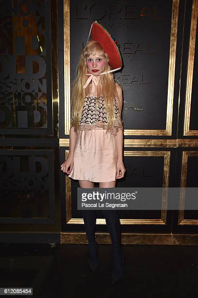 Petite Meller attends the Gold Obsession Party L'Oreal Paris Photocall as part of the Paris Fashion Week Womenswear Spring/Summer 2017 on October 2...