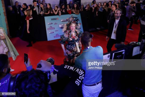 Petite Meller is interviewed on the red carpet during the MTV EMAs 2017 held at The SSE Arena Wembley on November 12 2017 in London England