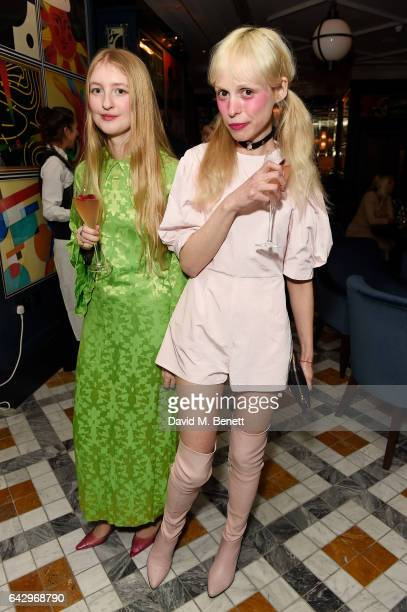 Petite Meller with guest attends the Mulberry Winter '17 LFW Aftershow Party at The Ivy Soho Brasserie on February 19 2017 in London England