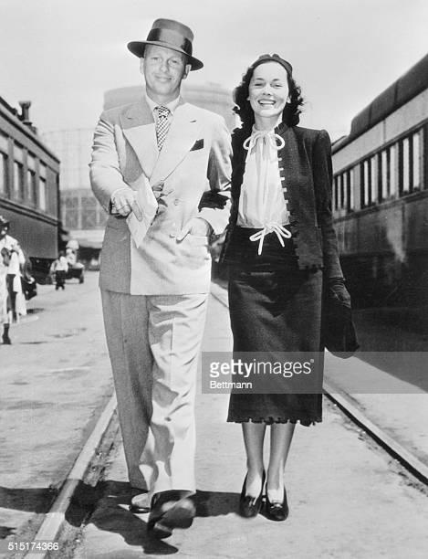 Petite MetroGoldwyn Mayer screen actress Maureen O'Sullivan and her film writer husband John Farrow have been married a yearnow they're honeymooning...
