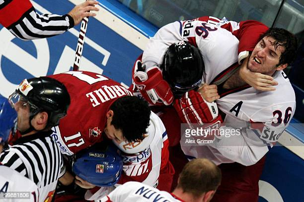 Petr Caslava of Czech Republic fights with Corey Perry of Canada during the IIHF World Championship group F qualification round match between Canada...