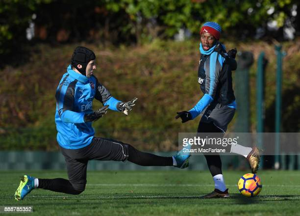 Petr Cech and Danny Welbeck of Arsenal during a training session at London Colney on December 9 2017 in St Albans England