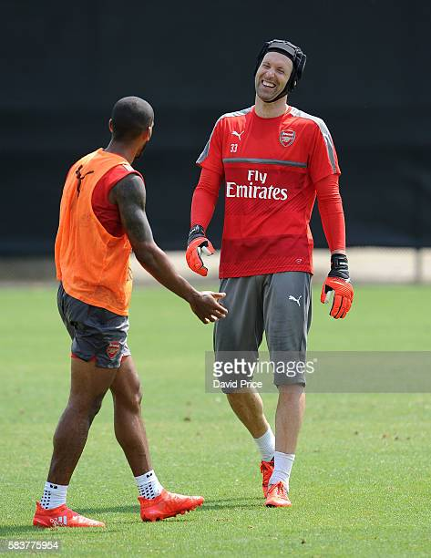 Petr Cech and Theo Walcott of Arsenal during the Arsenal Training Session at San Jose State University on July 27 2016 in San Jose California
