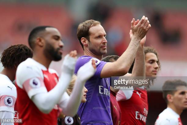 Petr Cech applauds fans as he farewells the club following the Premier League match between Arsenal FC and Brighton Hove Albion at Emirates Stadium...