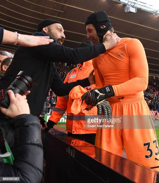 Petr Cech give his shirt to an Arsenal fan after the Premier League match between Southampton and Arsenal at St Mary's Stadium on December 10 2017 in...