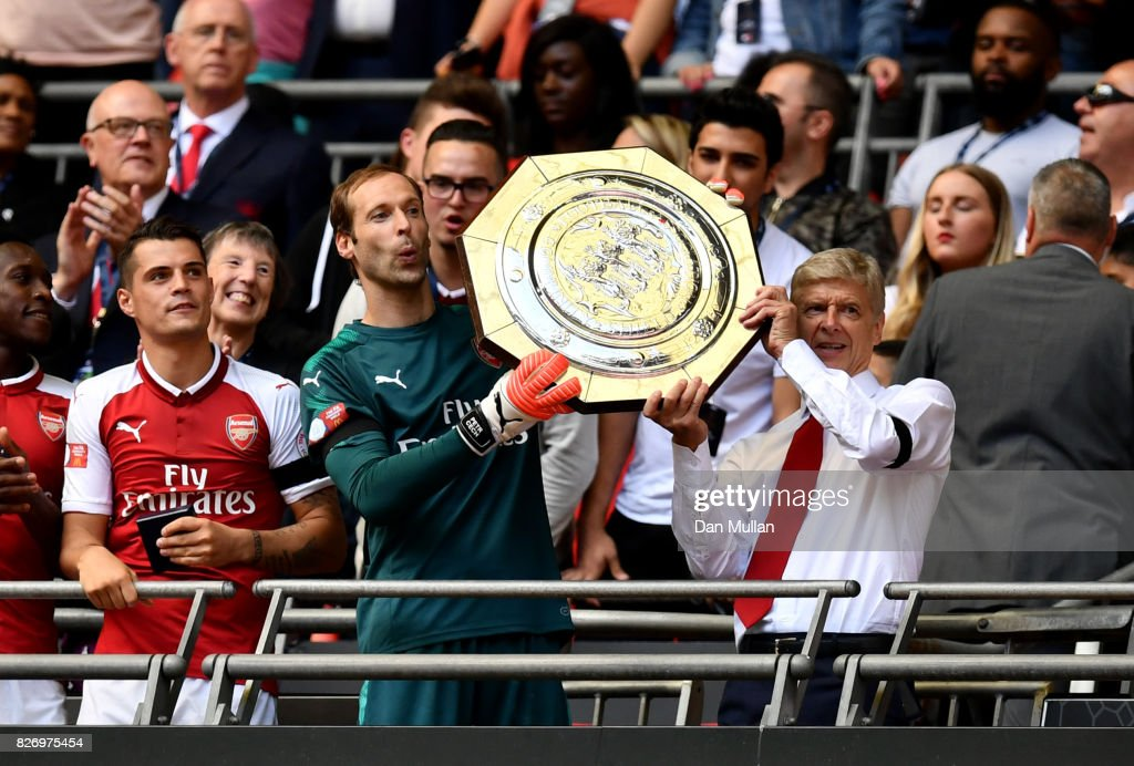 Petr Cech of Arsenal and Arsenal manager Arsene Wenger celebrate with the trophy following the The FA Community Shield final between Chelsea and Arsenal at Wembley Stadium on August 6, 2017 in London, England.