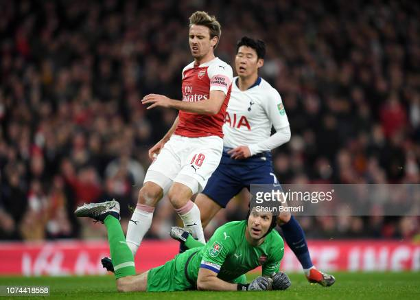 Petr Cech of Arsenal and Nacho Monreal of Arsenal react to Heung-Min Son of Tottenham Hotspur scoring his sides first goal during the Carabao Cup...