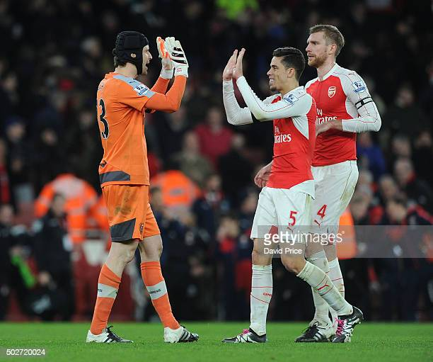 Petr Cech of Arsenal celebrates at the final whistle after breaking the record for Premier League clean sheets with Gabriel and Per Mertesacker after...