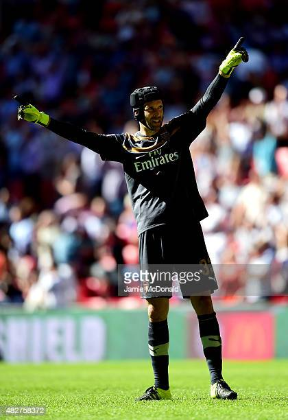 Petr Cech of Arsenal celebrates his team's 10 win in the FA Community Shield match between Chelsea and Arsenal at Wembley Stadium on August 2 2015 in...