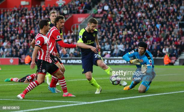 Petr Cech of Arsenal comes out to save as Shkodran Mustafi of Arsenal defends from Cedric Soares and Manolo Gabbiadini of Southampton during the...