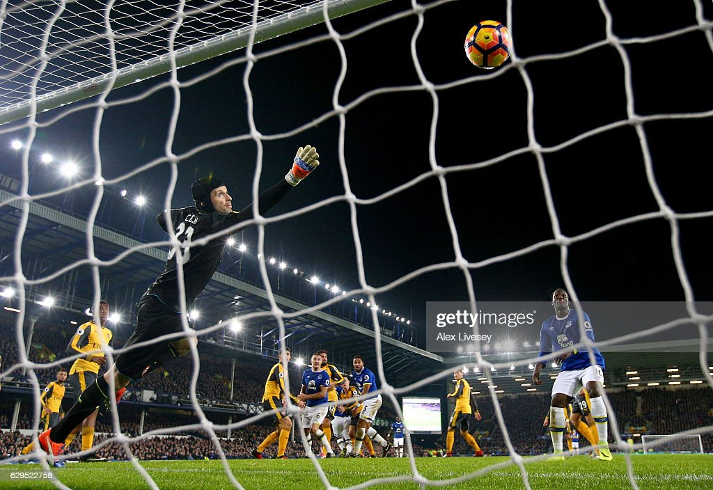 Petr Cech of Arsenal dives in vain as Ashley Williams #5 of Everton scores his team's second goal during the Premier League match between Everton and Arsenal at Goodison Park on December 13, 2016 in Liverpool, England.