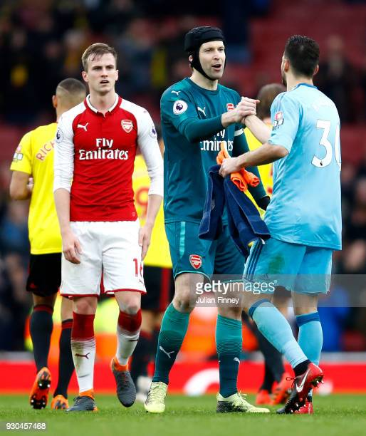Petr Cech of Arsenal embraces Orestis Karnezis of Wartford after the Premier League match between Arsenal and Watford at Emirates Stadium on March 11...