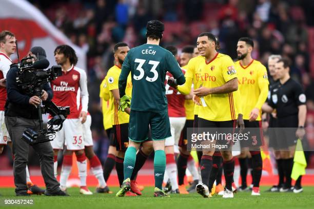 Petr Cech of Arsenal embraces Troy Deeney of Watford after the Premier League match between Arsenal and Watford at Emirates Stadium on March 11 2018...
