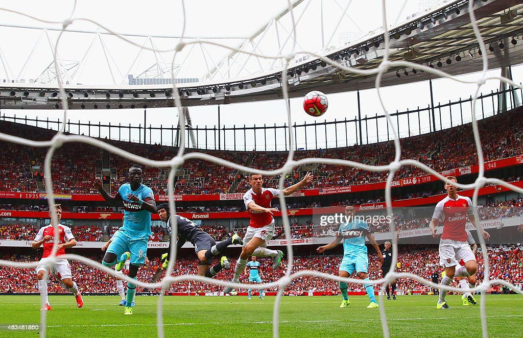 Petr Cech of Arsenal fails to punch clear the ball as Cheikhou Kouyate of West Ham United heads in the opening goal during the Barclays Premier League match between Arsenal and West Ham United at the Emirates Stadium on August 9, 2015 in London, England.