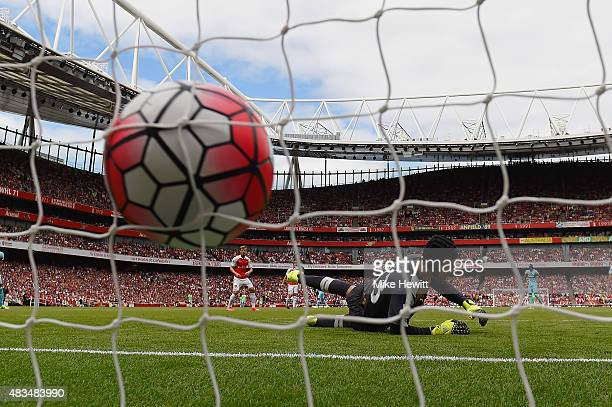 Petr Cech of Arsenal fails to stop Mauro Zarate of West Ham United scoring their second goal during the Barclays Premier League match between Arsenal...