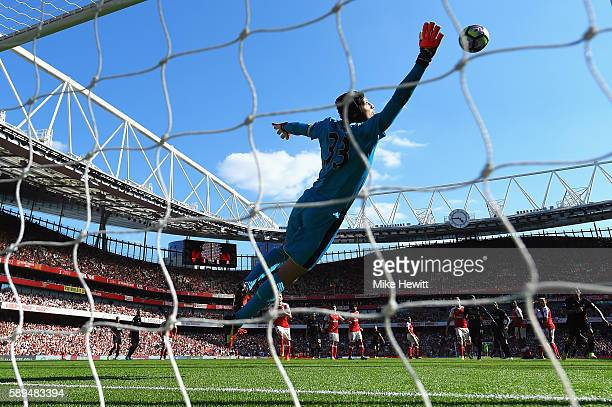 Petr Cech of Arsenal fails to stop the free kick by Philippe Coutinho of Liverpool during the Premier League match between Arsenal and Liverpool at...