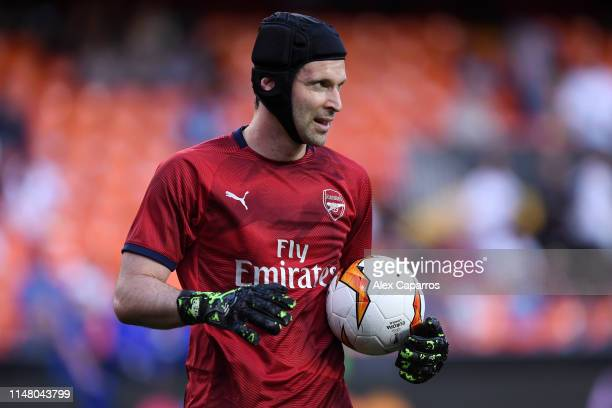 Petr Cech of Arsenal looks on as he warms up prior to the UEFA Europa League Semi Final Second Leg match between Valencia and Arsenal at Estadio...