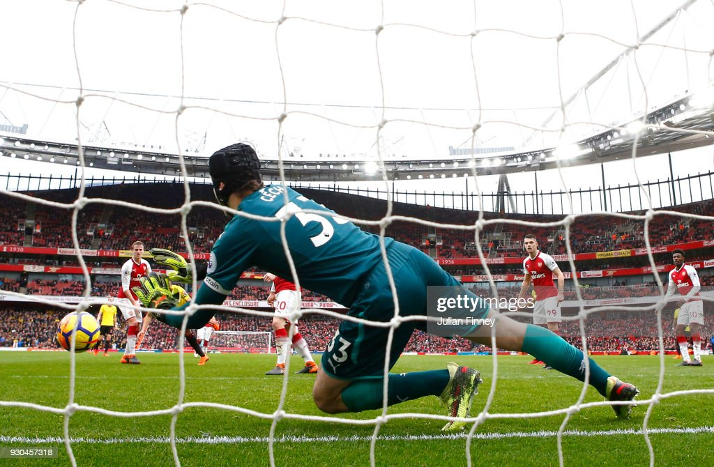 Petr Cech of Arsenal makes a save during the Premier League match between Arsenal and Watford at Emirates Stadium on March 11, 2018 in London, England.