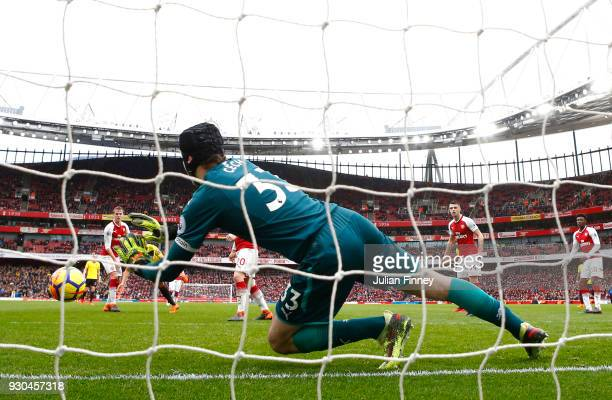 Petr Cech of Arsenal makes a save during the Premier League match between Arsenal and Watford at Emirates Stadium on March 11 2018 in London England
