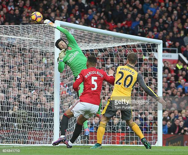 Petr Cech of Arsenal makes a save from Marcos Rojo of Manchester United in action during the Premier League match between Manchester United and...