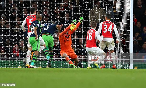 Petr Cech of Arsenal punches the ball away from which Ashley Williams of Swansea City scores a goal to make it 12 during the Barclays Premier League...