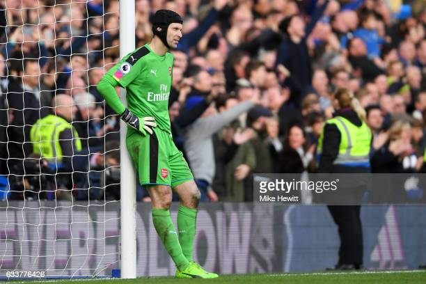 Petr Cech of Arsenal reacts after a mistake led to Cesc Fabregas of Chelsea scoring his team's thirs goal during the Premier League match between...