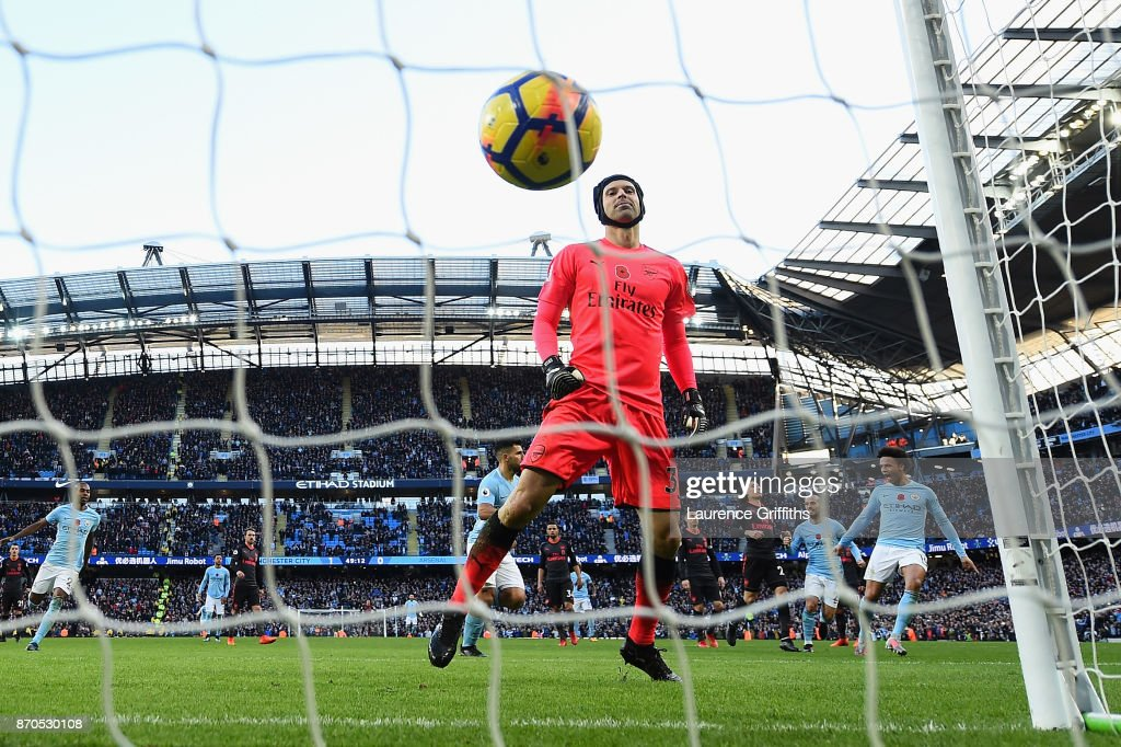Petr Cech of Arsenal reacts to conceding a penalty from Sergio Aguero of Manchester City (obscure) during the Premier League match between Manchester City and Arsenal at Etihad Stadium on November 5, 2017 in Manchester, England.