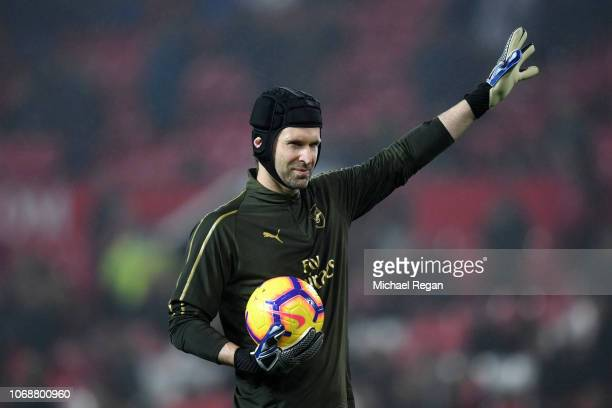 Petr Cech of Arsenal reacts when warming up prior to the Premier League match between Manchester United and Arsenal FC at Old Trafford on December 5...