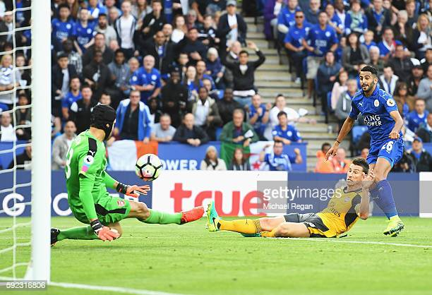 Petr Cech of Arsenal saves a Riyad Mahrez of Leicester City shot during the Premier League match between Leicester City and Arsenal at The King Power...