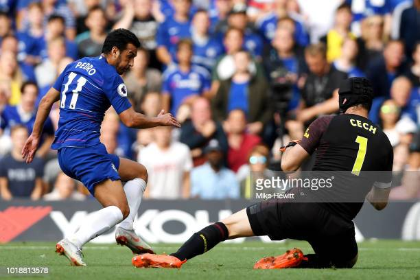 Petr Cech of Arsenal saves a shot from Pedro of Chelsea during the Premier League match between Chelsea FC and Arsenal FC at Stamford Bridge on...