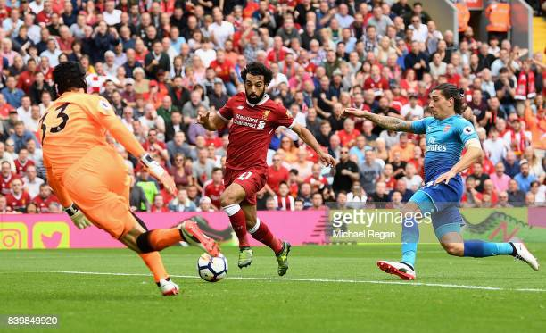 Petr Cech of Arsenal saves from Mohamed Salah of Liverpool during the Premier League match between Liverpool and Arsenal at Anfield on August 27 2017...
