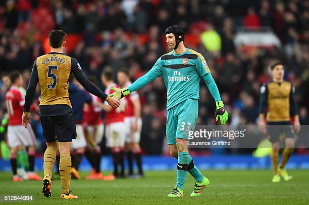 Petr Cech of Arsenal shakes hands with Gabriel Paulista of Arsenal after the Barclays Premier League match between Manchester United and Arsenal at...