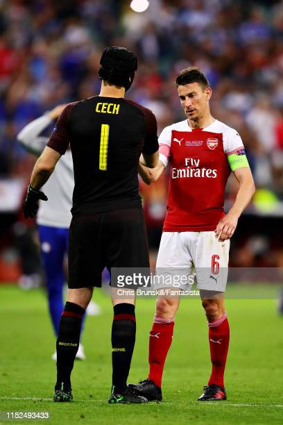Petr Cech of Arsenal shakes hands with teammate Laurent Koscielny after the UEFA Europa League Final between Chelsea and Arsenal at Baku Olimpiya...
