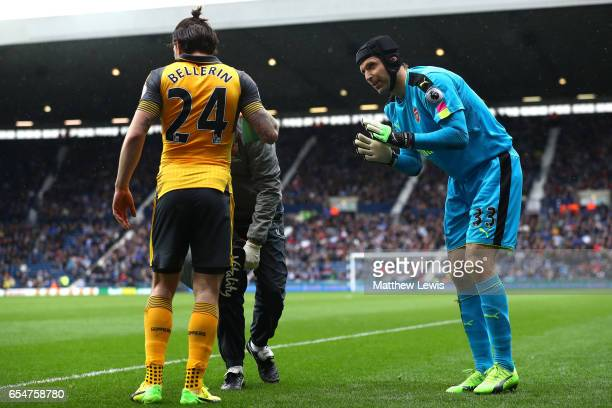 Petr Cech of Arsenal speaks to Hector Bellerin of Arsenal after he picks up a injury during the Premier League match between West Bromwich Albion and...