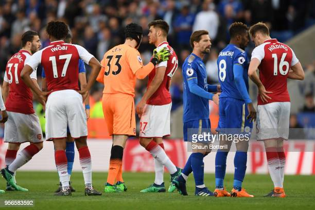 Petr Cech of Arsenal tells Konstantinos Mavropanos of Arsenal to leave the pitch after being sent offl during the Premier League match between...