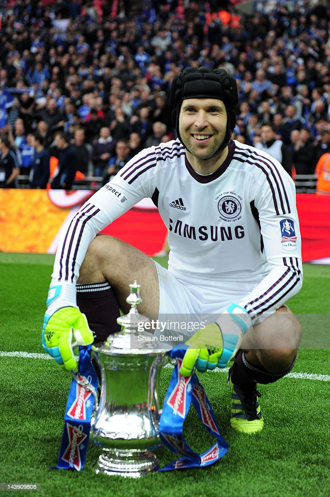 Petr Cech of Chelsea celebrates with the trophy after the FA Cup with Budweiser Final match between Liverpool and Chelsea at Wembley Stadium on May 5, 2012 in London, England.