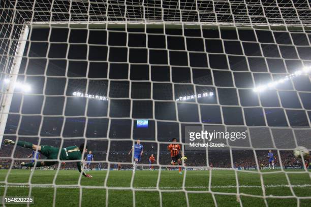 Petr Cech of Chelsea dives in vain as Fernandinho scores the second goal for Shakhtar Donetsk during the UEFA Champions League Group E match between...