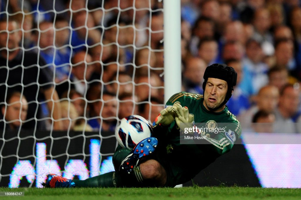 Petr Cech of Chelsea fails to stop Danny Guthrie of Reading's effort on goal during the Barclays Premier League match between Chelsea and Reading at Stamford Bridge on August 22, 2012 in London, England.