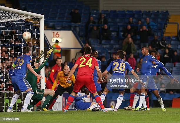 Petr Cech of Chelsea fails to stop Vlad Chiriches of FC Steaua Bucuresti scores their first goal during the UEFA Europa League Round of 16 second leg...