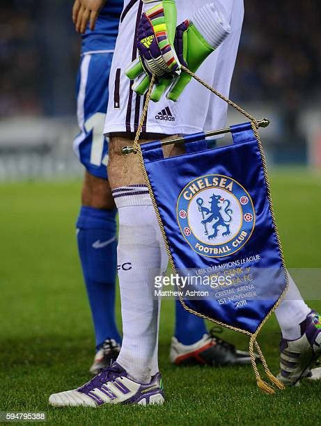Petr Cech of Chelsea holds a pennant